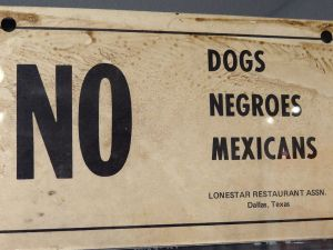 No_Dogs-Negroes-Mexicans_-_Racist_Sign_from_Deep_South_-_National_Civil_Rights_Museum_-_Downtown_Memphis_-_Tennessee_-_USA