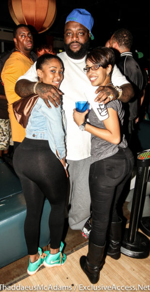Rick Ross poses with fans