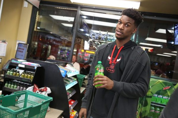 """NBA star Jimmy Butler enjoys a Mountain Dew during the filming of """"Make An Introduction"""", a television spot airing in the U.S. and Canada during NBA All-Star 2016 featuring DEW(R)athletes and 2016 NBA All-Stars Russell Westbrook and Jimmy Butler, and rising star Julius Randle. The shoot was held in Los Angeles on Jan. 27, 2016. (Casey Rodgers/AP Images for Mountain Dew) (PRNewsFoto/Mountain Dew)"""