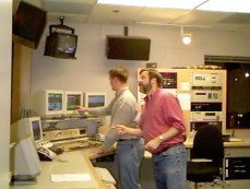 conferring during a break with producer Greg W. Smith in Master Control