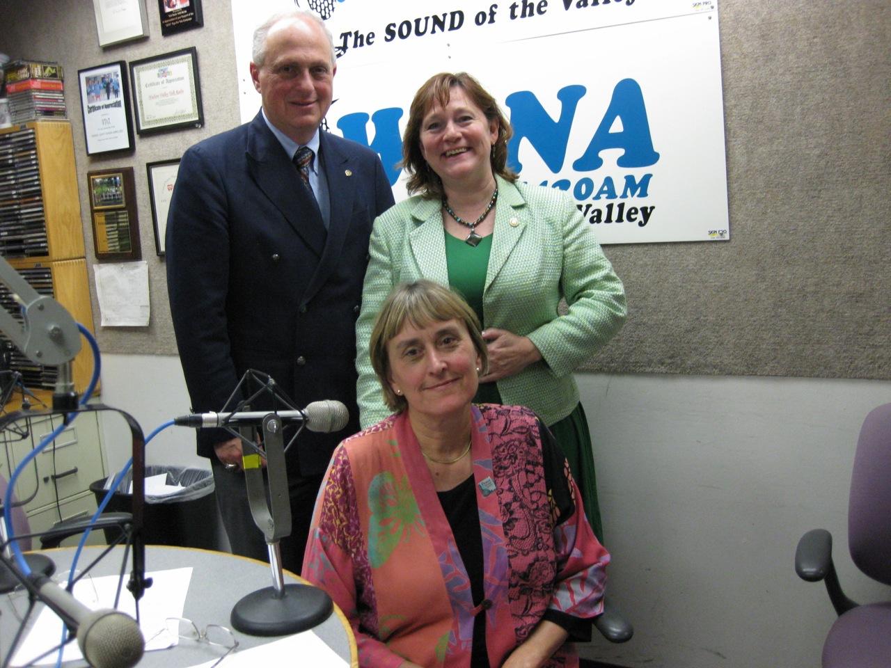 Seated Patty Moore Standing Co Hosts Jonah Triebwasser