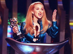 "NEW YORK, NY - SEPTEMBER 8: Madonna blows the crowd a kiss after receiving the award for Best Female Video 07 September during the 1995 MTV Video Music Awards held at Radio City Music Hall in New York. The award was for her ""Take A Bow"" video. AFP PHOTO (Photo credit should read DON EMMERT/AFP/Getty Images)"