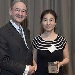 Award recipient Hua Li, PhD, with Chancellor Mark S. Wrighton.