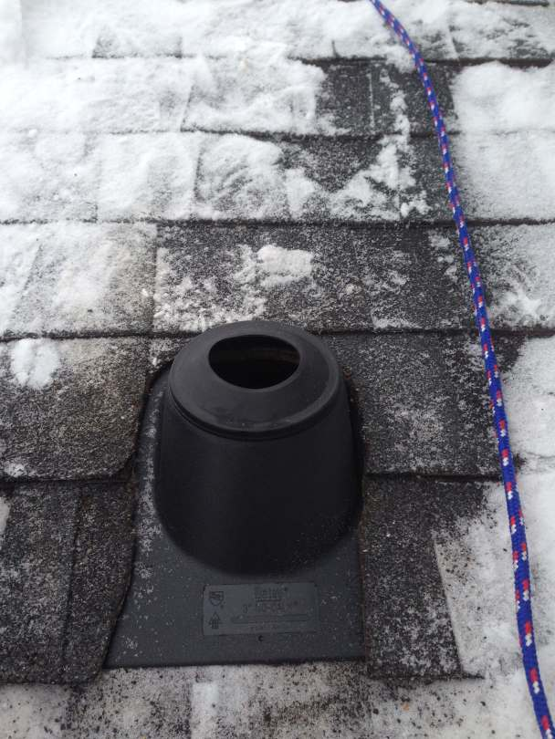 A roof boot installed on a roof for a radon mitigation system.