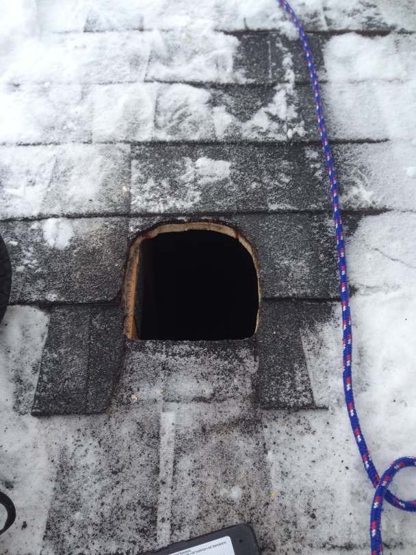 A hole in a roof for a radon mitigation system.