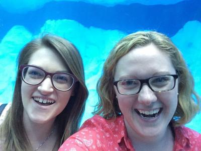 Becca + I at the zoo in Detroit, MI, trying to hang with the penguins!