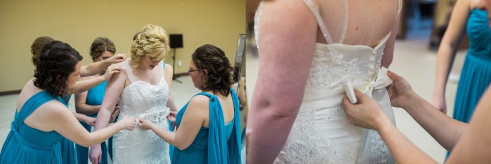 Bridesmaids put finishing touches on the bride