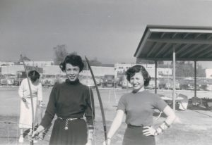 Eleanor Moscatel and a classmate practicing archery, circa 1950s