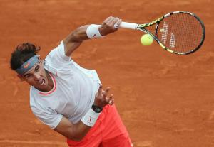 Nadal of Spain serves to Klizan of Slovakia during their men's singles match at the French Open tennis tournament in Paris