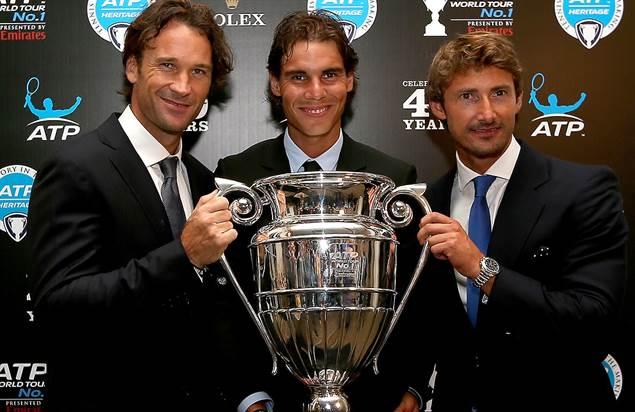 Spaniards Carlos Moya, Rafael Nadal and Juan Carlos Ferrero pose with the ATP World Tour No. 1 trophy. ©Ella Ling
