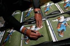 Rafael Nadal signs copies of the 'No. 1' book, celebrating 40 years of the Emirates ATP Rankings. ©Ella Ling