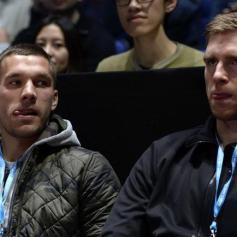 Lukas Podolski and Per Mertesacker (REUTERS/Dylan Martinez)
