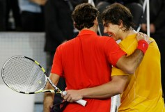 Switzerland's Roger Federer and Spain's Rafael Nadal embrace after Nadal won their charity tennis match in Madrid