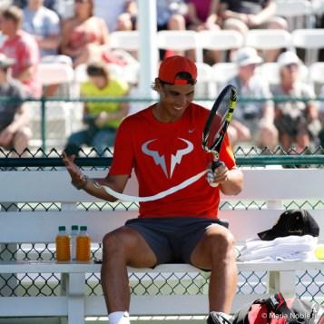 Rafa happily re-grips his racket. Photo by Maria Noble/Tennis View Magazine