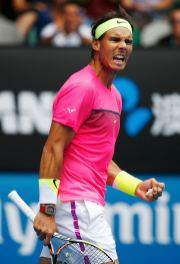 Nadal of Spain reacts after winning a point over Anderson of South Africa during their men's singles match at the Australian Open 2015 tennis tournament in Melbourne