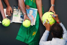 Nadal of Spain signs autographs after defeating Anderson of South Africa in their men's singles match at the Australian Open 2015 tennis tournament in Melbourne