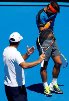 Spain's Rafael Nadal talks with his coach and uncle Toni Nadal during a practice session on Rod Laver Arena at Melbourne Park
