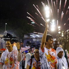 Former tennis player Kuerten of Brazil and tennis player Nadal of Spain attend the annual carnival parade in Rio de Janeiro