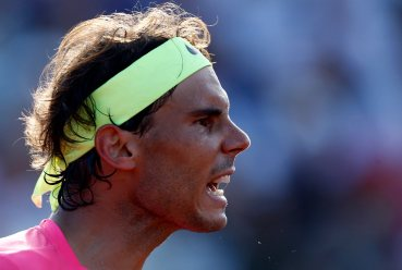 Nadal reacts after winning a point during his tennis match against Berlocq at the ATP Argentina Open in Buenos Aires