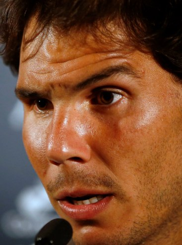 Nadal of Spain speaks during a news conference ahead of the Rio Open 2015 tennis tournament in Rio de Janeiro