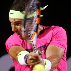 Nadal of Spain returns to Bellucci of Brazil during their men's singles tennis match at the Rio Open