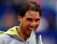 Spain's Rafael Nadal bites the trophy after winning his final match against Argentina's Juan Monaco at the ATP Argentina Open tennis tournament in Buenos Aires