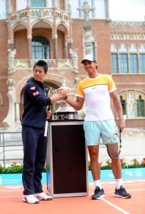 Rafael Nadal and Kei Nishikori pose in front of the Sant Pau Recinte Modernista in Barcelona 2015