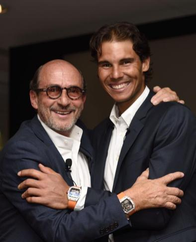 Richard Mille poses with Rafael Nadal on May 23, 2015 in Paris. AFP PHOTO / ERIC FEFERBERG