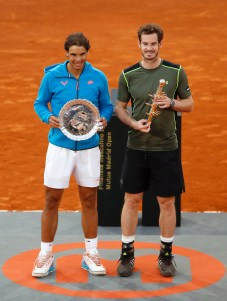 Rafael Nadal of Spain, left, and Andy Murray of Great Britain pose with their trophies at the end of the final of the Madrid Open Tennis tournament in Madrid, Spain, Sunday, May 10, 2015. Murray defeated Nadal 6/3, 6/2. (AP Photo/Daniel Ochoa de Olza)