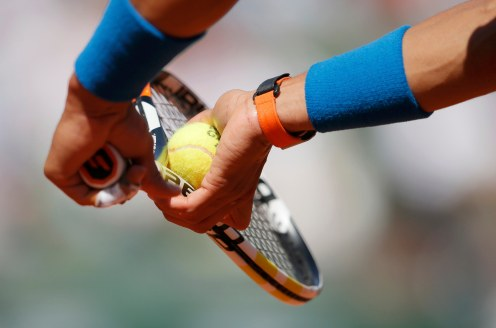 A close-up picture shows Rafael Nadal of Spain as he prepares to serve to Andrey Kuznetsov of Russia during their men's singles match at the French Open tennis tournament at the Roland Garros stadium in Paris, France, May 30, 2015. REUTERS/Gonzalo Fuentes