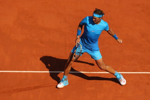 PARIS, FRANCE - MAY 30: Rafael Nadal of Spain celebrates match point in his Men's Singles match against Andrey Kuznetsov of Russia on day seven of the 2015 French Open at Roland Garros on May 30, 2015 in Paris, France. (Photo by Clive Brunskill/Getty Images)