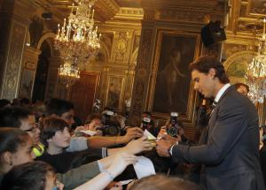 Tennis player Rafael Nadal signs autographs after he received the Grand Vermeil Paris medal from Paris Mayor Anne Hidalgo during a ceremony at the Paris City Hall, in Paris, France, Thursday, May 21, 2015. By winning the 2014 French Open, Nadal became the only male player to win a single Grand Slam tournament nine times and he begins defense his title on the upcoming French Open at Roland Garros stadium next week. (AP Photo/Francois Mori)