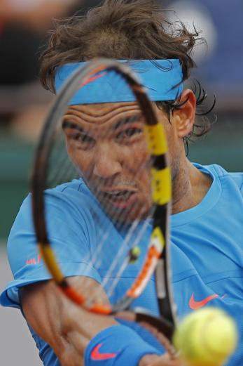 Spain's Rafael Nadal returns in the second round match of the French Open tennis tournament against Spain's Nicolas Almagro at the Roland Garros stadium, in Paris, France, Thursday, May 28, 2015. (AP Photo/Christophe Ena)