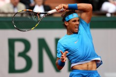 PARIS, FRANCE - MAY 26: Rafael Nadal of Spain returns a shot in his Men's Singles match against Quentin Halys of France on day three of the 2015 French Open at Roland Garros on May 26, 2015 in Paris, France. (Photo by Clive Brunskill/Getty Images)
