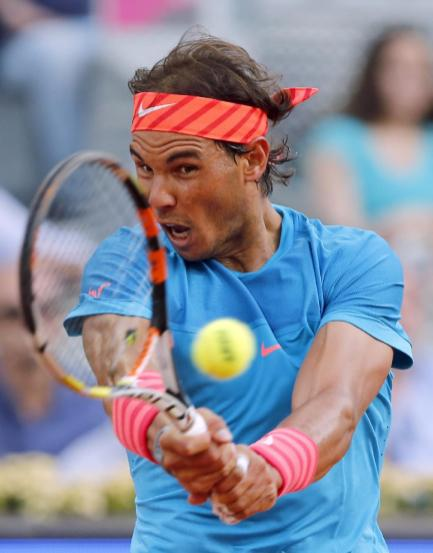 Rafael Nadal of Spain returns a shot to Andy Murray of Britain during their men's singles final match at the Madrid Open Tennis tournament in Madrid, Spain, Sunday, May 10, 2015. (AP Photo/Paul White)