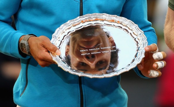 MADRID, SPAIN - MAY 10:  Rafael Nadal of Spain  looks at his reflection in his runners up trophy after his straight sets defeat against  Andy Murray of Great Britain in the mens final during day nine of the Mutua Madrid Open tennis tournament at the Caja Magica  on May 10, 2015 in Madrid, Spain.  (Photo by Clive Brunskill/Getty Images)