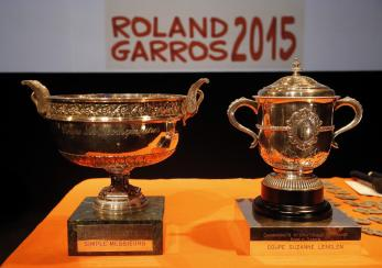 The men singles trophy, left, and the women signes trophy are pictured before the draw for the French Tennis Open at the Roland Garros stadium, Friday, May 22, 2015 in Paris, France. The French Open starts Sunday. (AP Photo/Francois Mori)