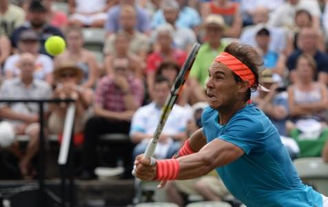 Spain's Rafael Nadal returns a ball to Australia's Bernard Tomic, during the quarterfinal match at the Mercedes Cup ATP tennis tournament in Stuttgart, Germany, Friday June 12, 2015. (Marijan Murat/dpa, via AP)