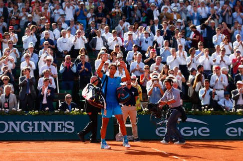 Rafael Nadal of Spain waves to the fans after defeat in his Men's quarter final match against Novak Djokovic of Serbia on day eleven of the 2015 French Open at Roland Garros on June 3, 2015 in Paris, France. (June 2, 2015 - Source: Julian Finney/Getty Images Europe)