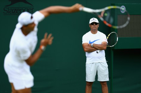 LONDON, ENGLAND - JUNE 27: Rafael Nadal of Spain is watched by his coach Toni Nadal during a practice session prior to the Wimbledon Lawn Tennis Championships at the All England Lawn Tennis and Croquet Club on June 27, 2015 in London, England. (Photo by Clive Brunskill/Getty Images)
