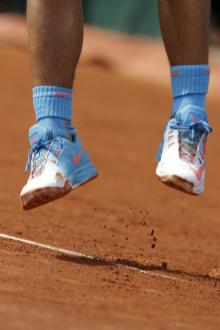 Spain's Rafael Nadal kicks up the clay as he serves in the fourth round match of the French Open tennis tournament against Jack Sock of the U.S. at the Roland Garros stadium, in Paris, France, Monday, June 1, 2015. (AP Photo/Thibault Camus)