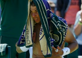 Rafael Nadal of Spain with a towel on his head during a break between games of his match against Thomaz Bellucci of Brazil at the Wimbledon Tennis Championships in London, June 30, 2015. REUTERS/Stefan Wermuth