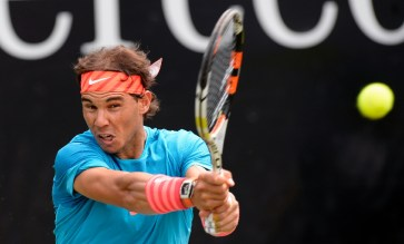Spain's Rafael Nadal returns the ball to Marcos Baghdatis of Cyprus in their round of sixteen match at the ATP Mercedes Cup tennis tournament in Stuttgart, southern Germany, on June 11, 2015 (AFP Photo/Thomas Kienzle)