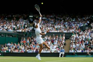 Rafael Nadal of Spain hits a smash during his match against Dustin Brown of Germany at the Wimbledon Tennis Championships in London, July 2, 2015. REUTERS/Stefan Wermuth