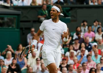Rafael Nadal of Spain celebrates after winning the second set during his match against Dustin Brown of Germany at the Wimbledon Tennis Championships in London, July 2, 2015. REUTERS/Stefan Wermuth