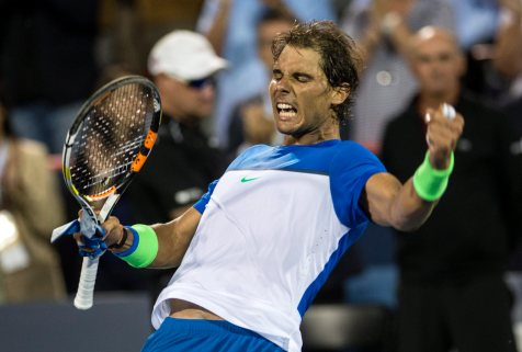 Rafael Nadal, of Spain, celebrates his victory over Mikhail Youzhny, of Russia, at the Rogers Cup tennis tournament Thursday. Aug. 13, 2015, in Montreal. (Paul Chiasson/The Canadian Press via AP)