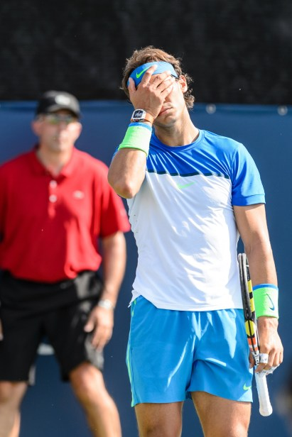 MONTREAL, ON - AUGUST 10: Rafael Nadal of Spain reacts during day one of the Rogers Cup at Uniprix Stadium in his doubles match against Tomas Berdych of the Czech Republic and Jack Sock of the USA on August 10, 2015 in Montreal, Quebec, Canada. (Photo by Minas Panagiotakis/Getty Images)