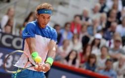 Spain's Rafael Nadal returns a shot during the semifinal match against Andreas Seppi of Italy at the ATPtennis tournament in Hamburg, Germany, Saturday Aug. 1, 2015. (Daniel Reinhardt/dpa via AP)