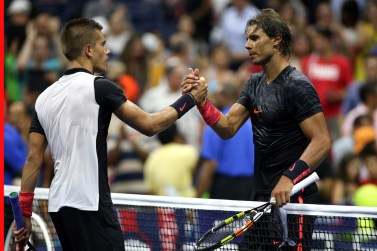 Rafael Nadal (R) of Spain shakes hands with Borna Coric (L) of Croatia after their Men's Singles First Round match on Day One of the 2015 US Open at the USTA Billie Jean King National Tennis Center on August 31, 2015 in the Flushing neighborhood of the Queens borough of New York City. (Aug. 30, 2015 - Source: Clive Brunskill/Getty Images North America)