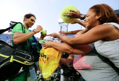 Rafael Nadal, of Spain, signs autographs for fans after beating Diego Schwartzman, of Argentina, during the second round of the U.S. Open tennis tournament, Wednesday, Sept. 2, 2015, in New York. (AP Photo/Frank Franklin II)
